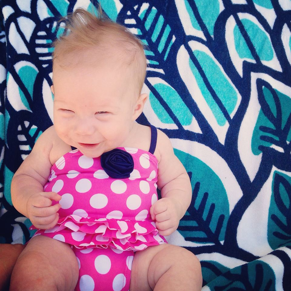 happy baby in pink