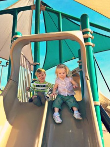 A helping hand…to shove her down the biggest slide ever – Wordless Wednesday